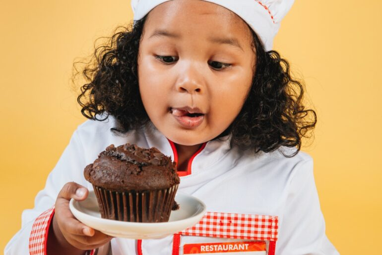 kid with a cupcake